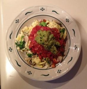 Veggie egg scramble topped with homemade salsa + guac