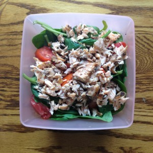 Leftover salmon on a spinach salad