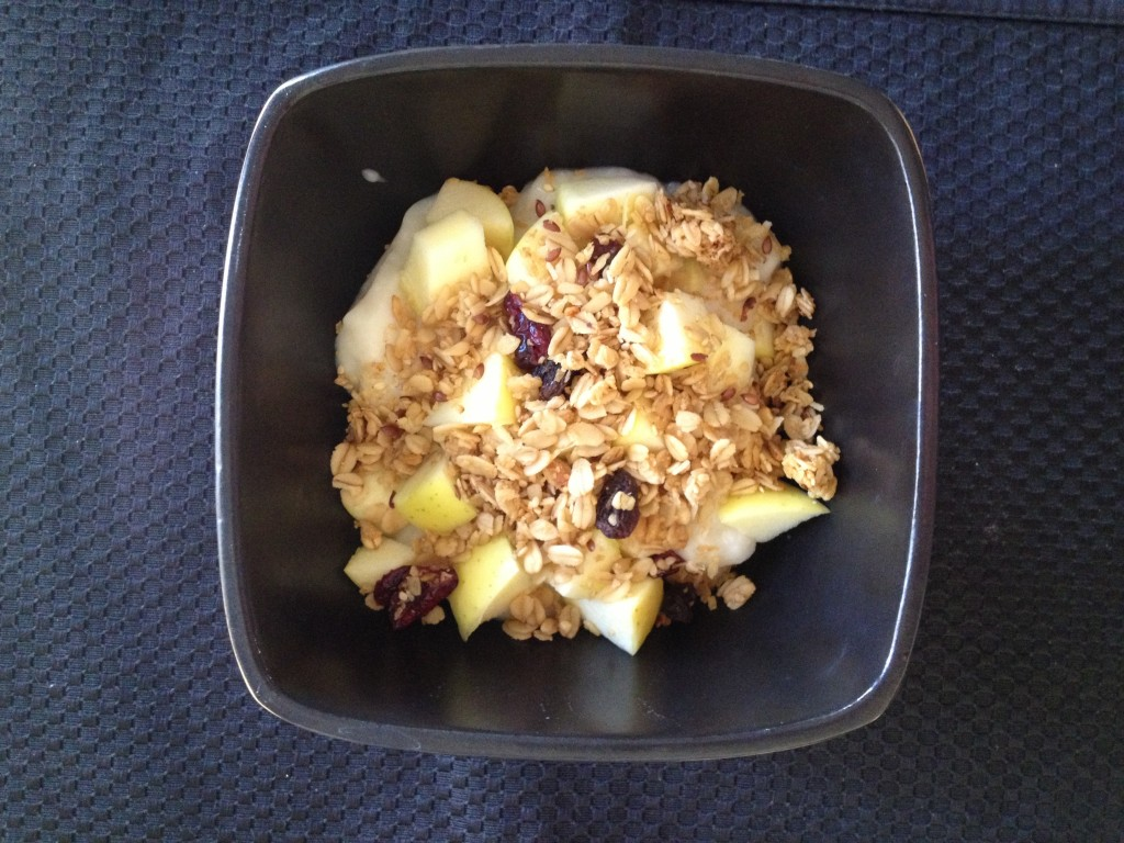 Yogurt bowl with chopped up apple and granola