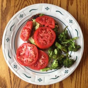 veggie burger w/ avocado, lots of garden fresh tomatoes and roasted broccoli